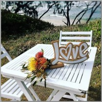 Square wedding signing table with love sign & native flowers.