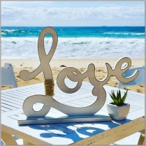 Wedding signing table with beach love sign & succulent.