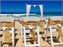 Burlap wedding chair sashes. Buddina Beach, Sunshine Coast.