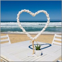 Wedding ceremony signing table with love heart & succulent. Buddina Beach, Sunshine Coast.