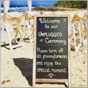 Chalk board with unplugged ceremony message.