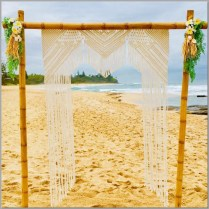 Bamboo wedding arbour styled with macrame backdrop, greenery & frangipani faux flowers. Shelly Bech, Caloundra.