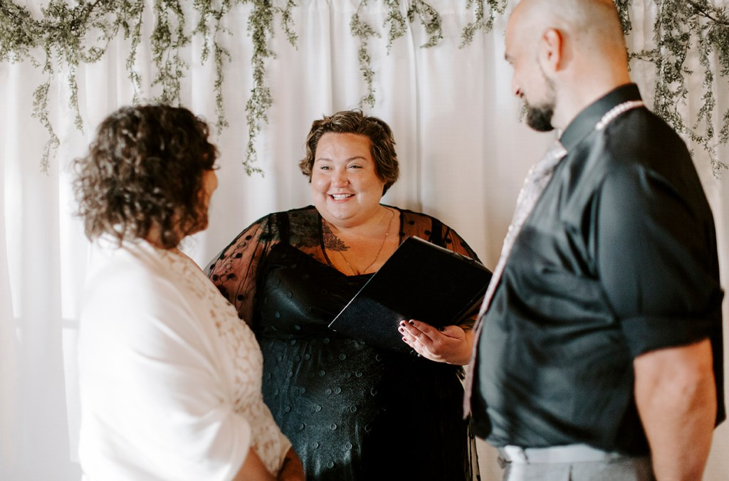 Couple getting married with groom's sister officiating