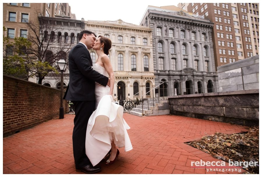 Tracey + Tim share a wedding day kiss a few minutes after first seeing each other on their wedding day.