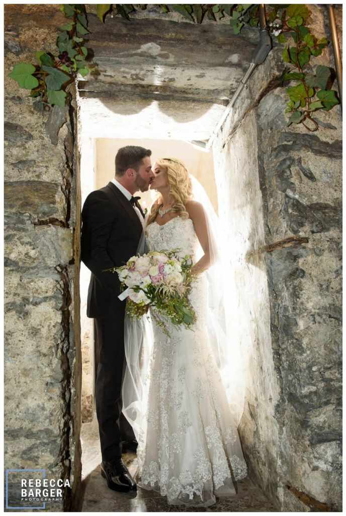 A just married kiss in the wine cellar of Philadelphia's Knowlton Mansion.