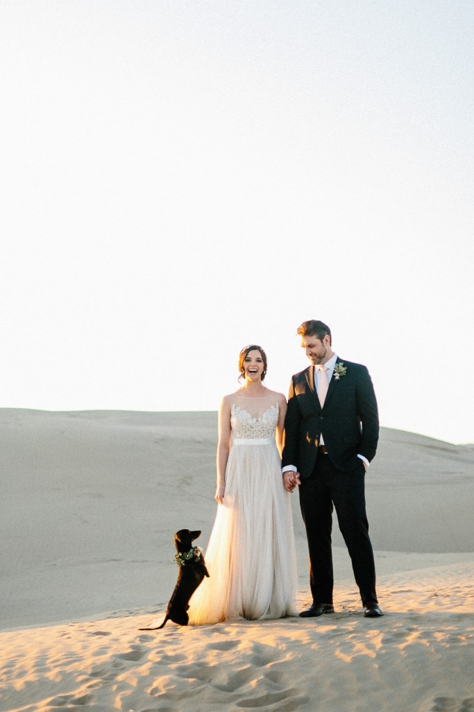 bride and groom with dachshund