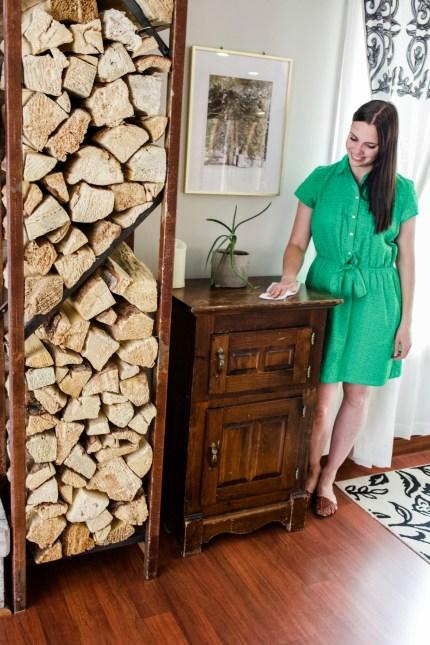 woman dusting furniture