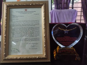 Metal plaque and letter frame of award
