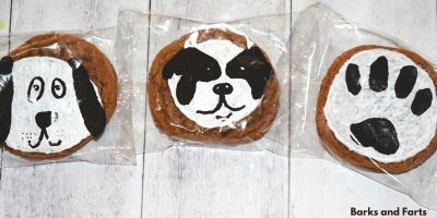 three cookies with designs for dogs and treats for humans.