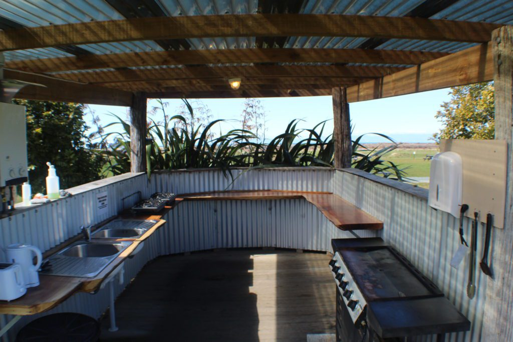 The Barn outdoor kitchen looking out over the Tasman Sea