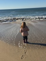 Poplar Beach. Seconds later, she got soaked by a rogue wave.