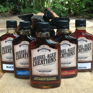 shop, barrel aged creations, purchase barrel aged sauce, where to buy bourbon maple, maple syrup, sriracha, balsamic vinegar, cook sauce, gourmet, barrel aged products