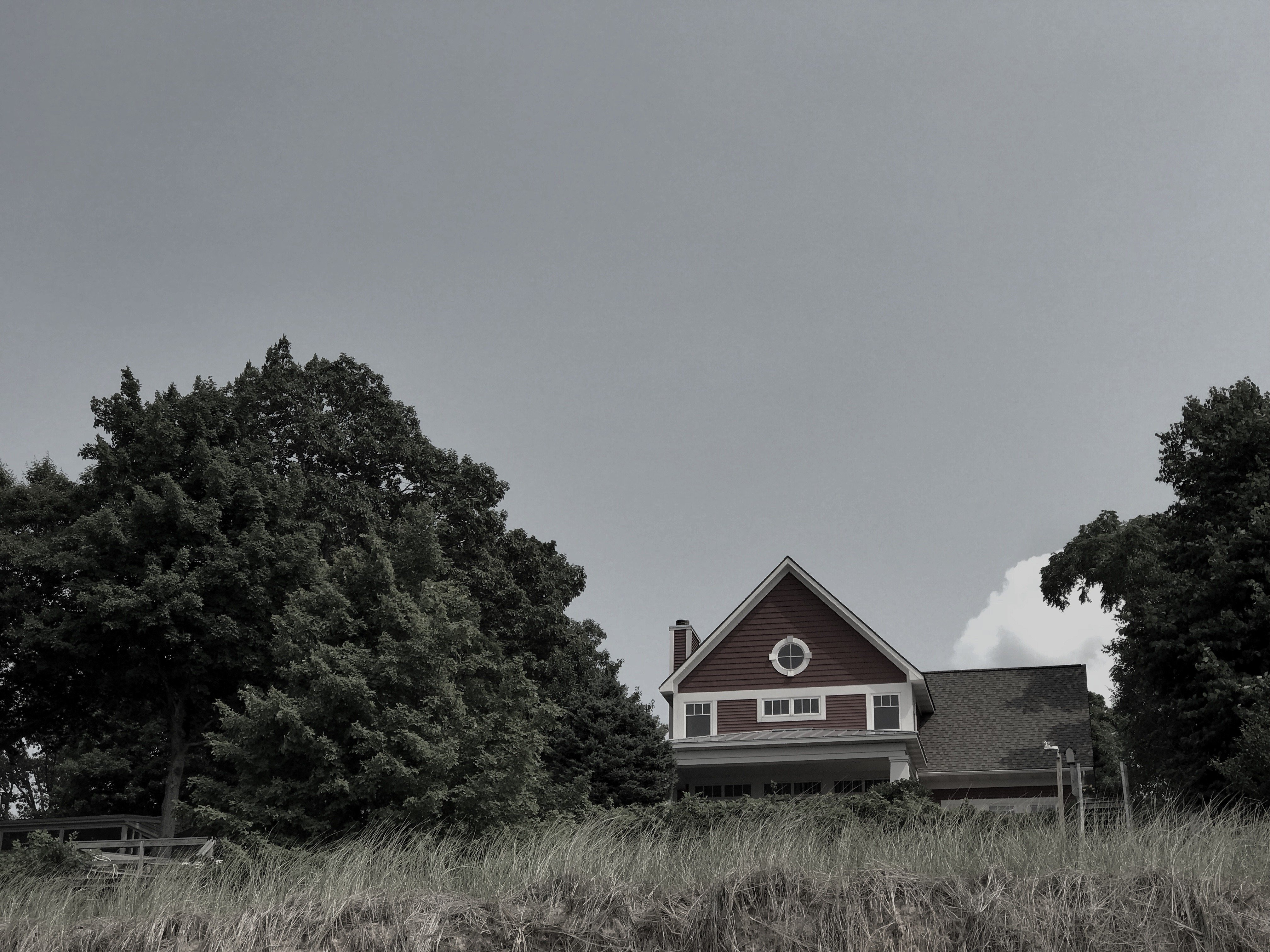a red house in the trees