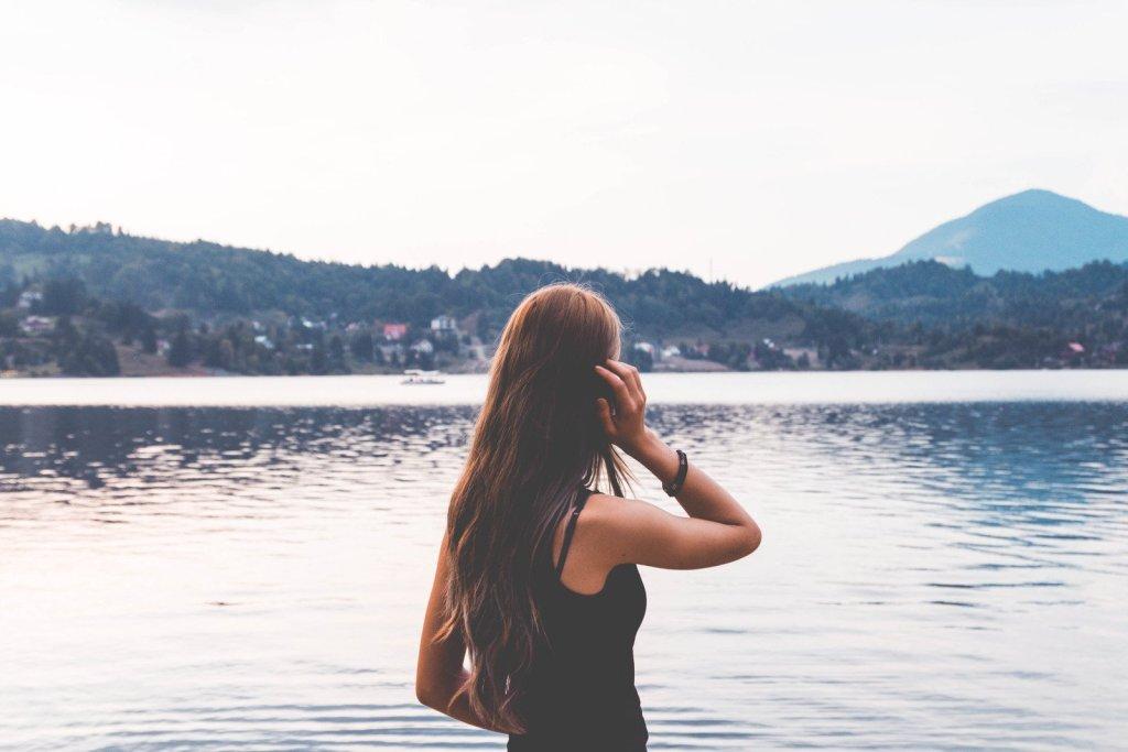 woman lookinb at water