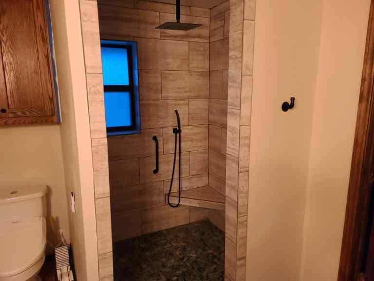 Complete bathroom remodeling pebble shower floor