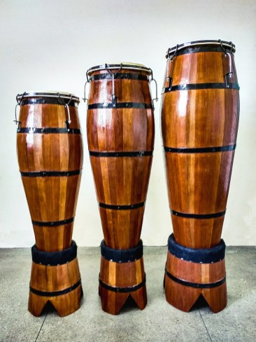 "a trio of ""atabaque drums"
