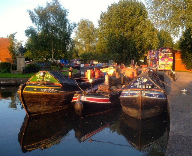 A few working boats at the start of the walkway to the festival field