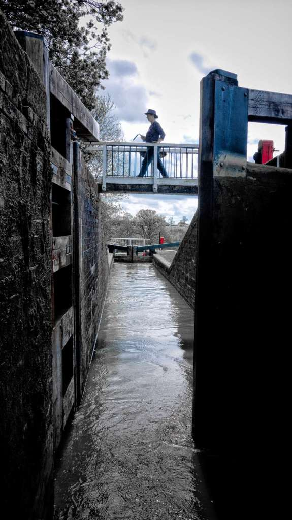 Sandra crossing the bridge over the Watford Staircase Lock.