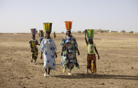 Mariama collecting water