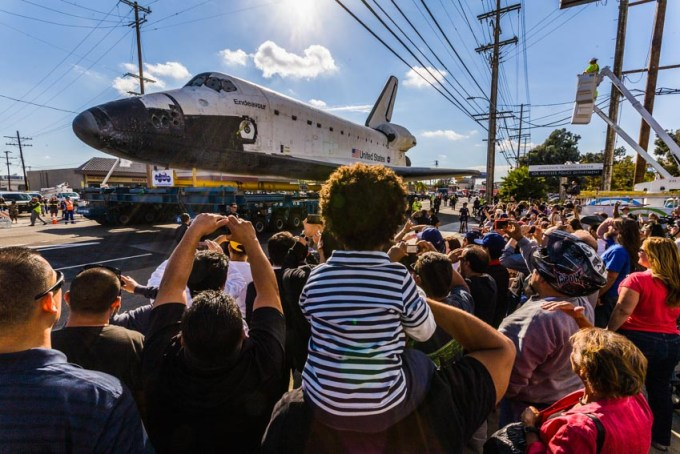 Space Shuttle Endeavour travels on Manchester Blvd. to 405 Freeway bridge.