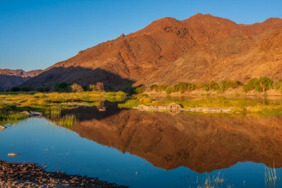 A mountain perfectly reflected in the Orange River