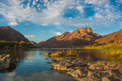 The sun rises over a picturesque scene on the Orange River