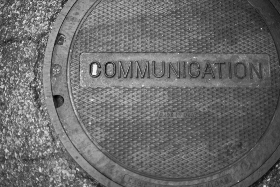 Manhole cover with the word communication on it