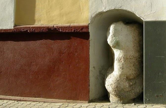 curiosities in seville man of stone