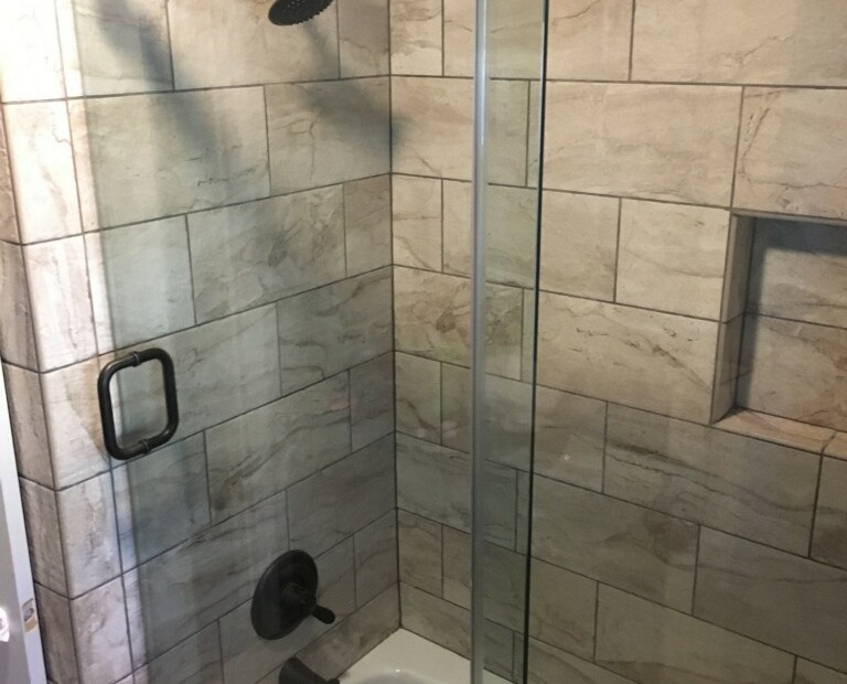 A Waterslide Custom Frameless Shower Enclosure