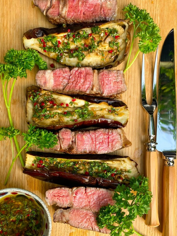 Grilled Ribeye steak with baked aubergine and chimichurri