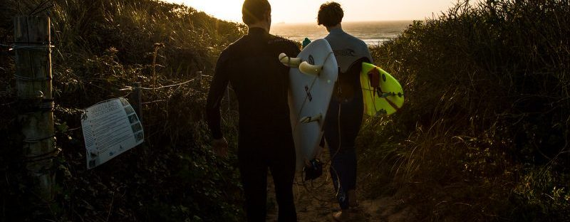 Surf and Stay Packages Newquay, surfers at sunset