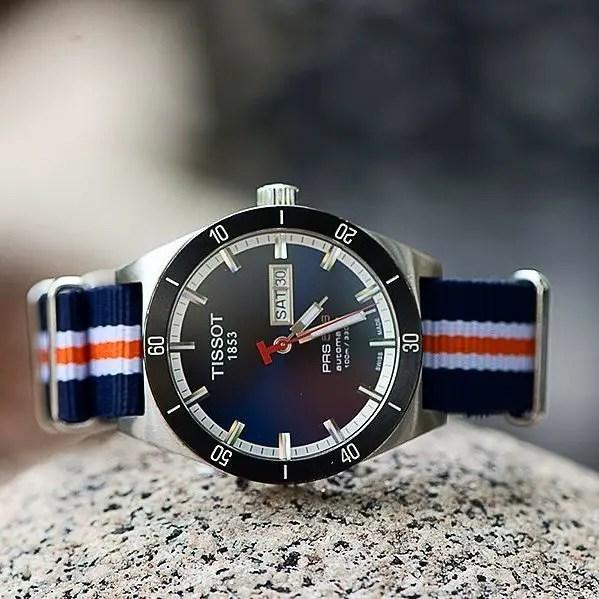 Clockwork Synergy Navy White & Orange Classic NATO strap on a Tissot 1853 PRS 516