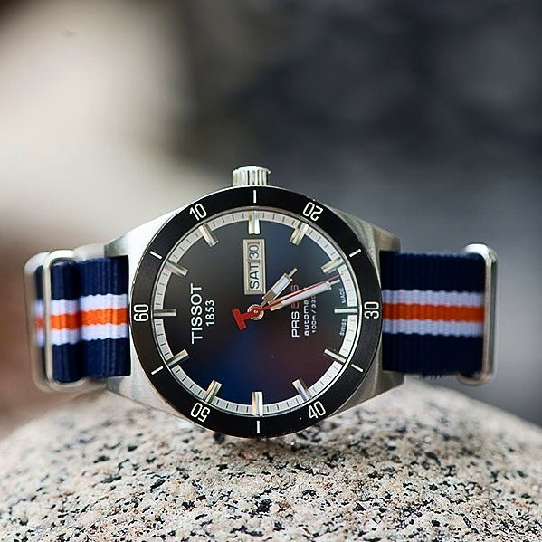 Clockwork Synergy Navy White & Orange Classic NATO strap on a Tissot 1853 PRS 516
