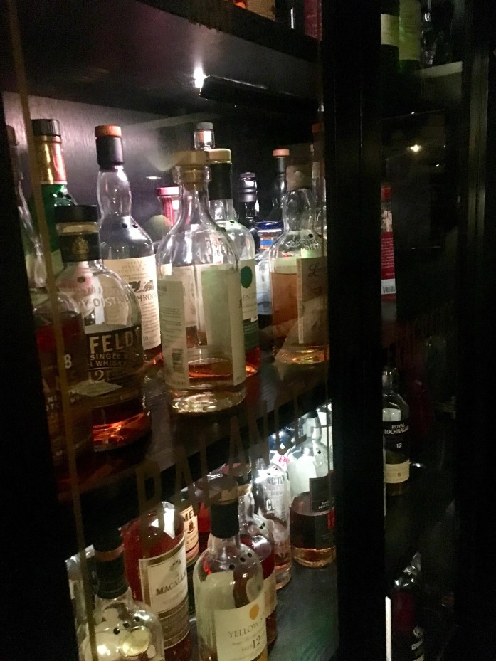 bookshelf of whisky at black rock bar london