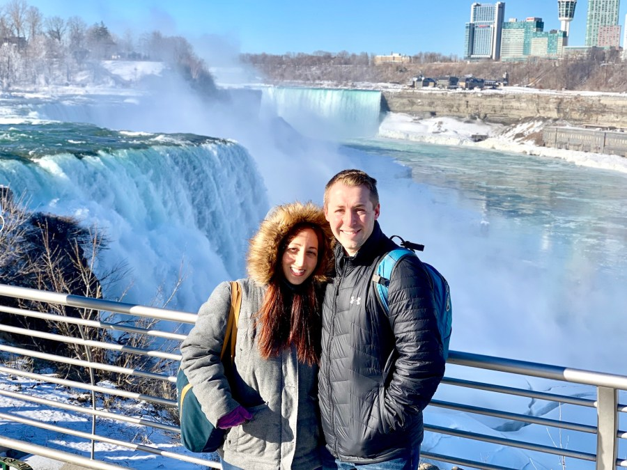 Couple standing in front of Niagara Falls