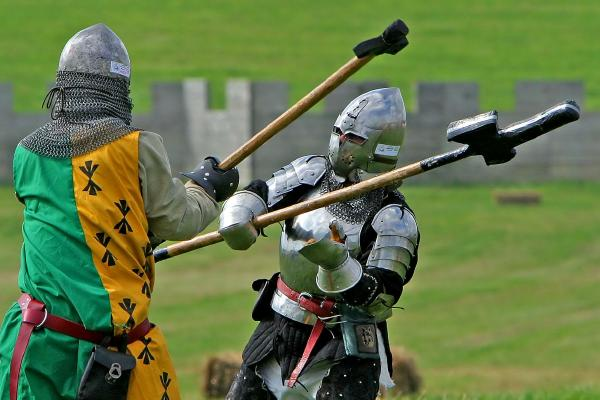 SCA Media photograph of two heavy list fighters engaged in combat at Pennsic War.