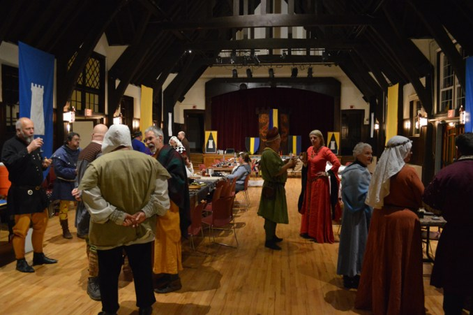 Image of the Feast of Saint Sylvester site with participants in medieval garb socializing.