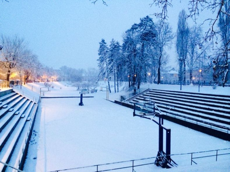 Outdoor Basketball Court Under Snow