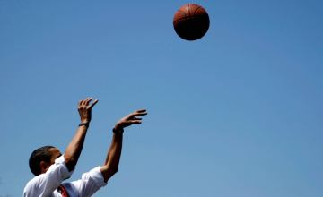 Obama shooting a basketball hoop
