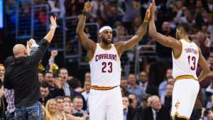 CLEVELAND, OH - FEBRUARY 11: LeBron James #23 celebrates with Tristan Thompson #13 of the Cleveland Cavaliers after James scored during the first half against the Miami Heat at Quicken Loans Arena on February 11, 2015 in Cleveland, Ohio. NOTE TO USER: User expressly acknowledges and agrees that, by downloading and or using this photograph, User is consenting to the terms and conditions of the Getty Images License Agreement. (Photo by Jason Miller/Getty Images)  *** Local Caption *** LeBron James; Tristan Thompson