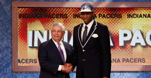 NEWARK, NJ - JUNE 23: Kawhi Leonard from San Diego State greets NBA Commissioner David Stern after he was selected #15 overall by the Indiana Pacers in the first round during the 2011 NBA Draft at the Prudential Center on June 23, 2011 in Newark, New Jersey. NOTE TO USER: User expressly acknowledges and agrees that, by downloading and/or using this Photograph, user is consenting to the terms and conditions of the Getty Images License Agreement. (Photo by Mike Stobe/Getty Images)