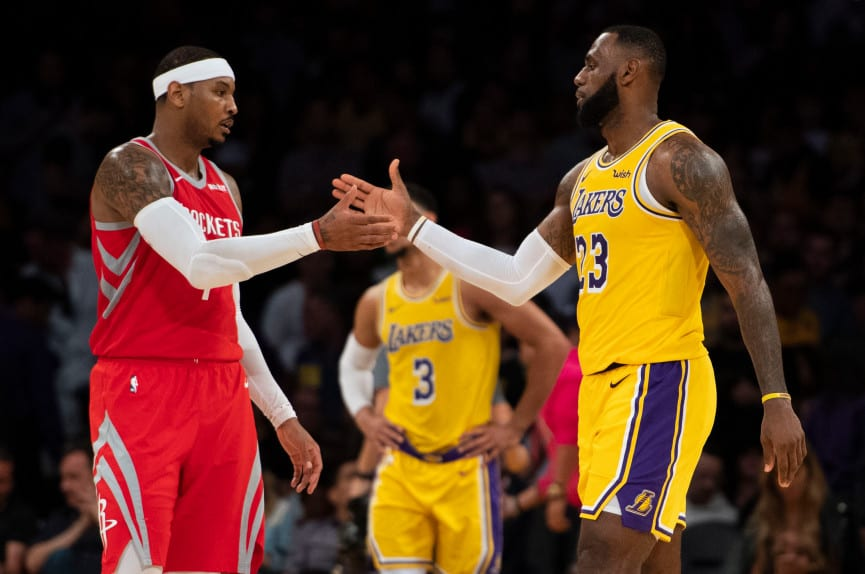 749115a6de83 Carmelo Anthony  7 of the Houston Rockets shakes hands with his good friend  LeBron James  23 of the Los Angeles Lakers after the Lakers  home opener  against ...