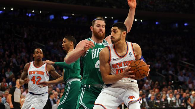 Enes Kanter posts up Celtics center Aron Barynes
