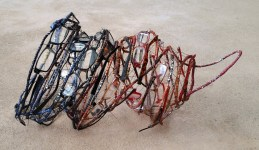 fibre sculpture made from telephone wire and reclaimed plastic reading glasses