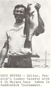 Bass Club News 1974. Dave Myers, of the Saddleback Bassmasters and also head of Fenwick R&D hoists an 8lb largemouth taken from Lake Mojave in a club tournament. Photo June 1974 issue of California Lunker Club newsletter.