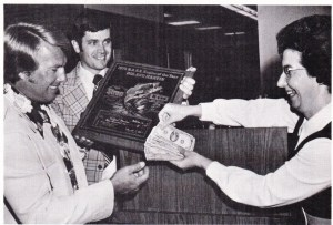 Roland Martin accepts the AOY trophy and cash for the fourth time in his career. Photo February 1976 Issue of Bassmaster Magazine.