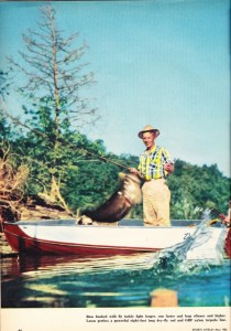 Jason Lucas, fishing editor for Sports Afield, fights a bass on a fly rod. May 1956 Sports Afield Bass Issue.