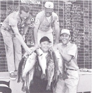 Blake Honeycutt, Bill Dance and Ray Scott help Rip Nunnery hold up his 98-15 one-day limit of bass at the 1969 Lake Eufaula Bass Master event. Photo Fall 1969 issue of Bass Master Magazine.