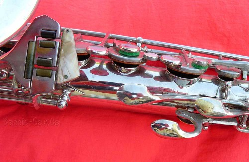 saxophone, keys, tone holes, nickel plated, mother of pearl, red cloth background