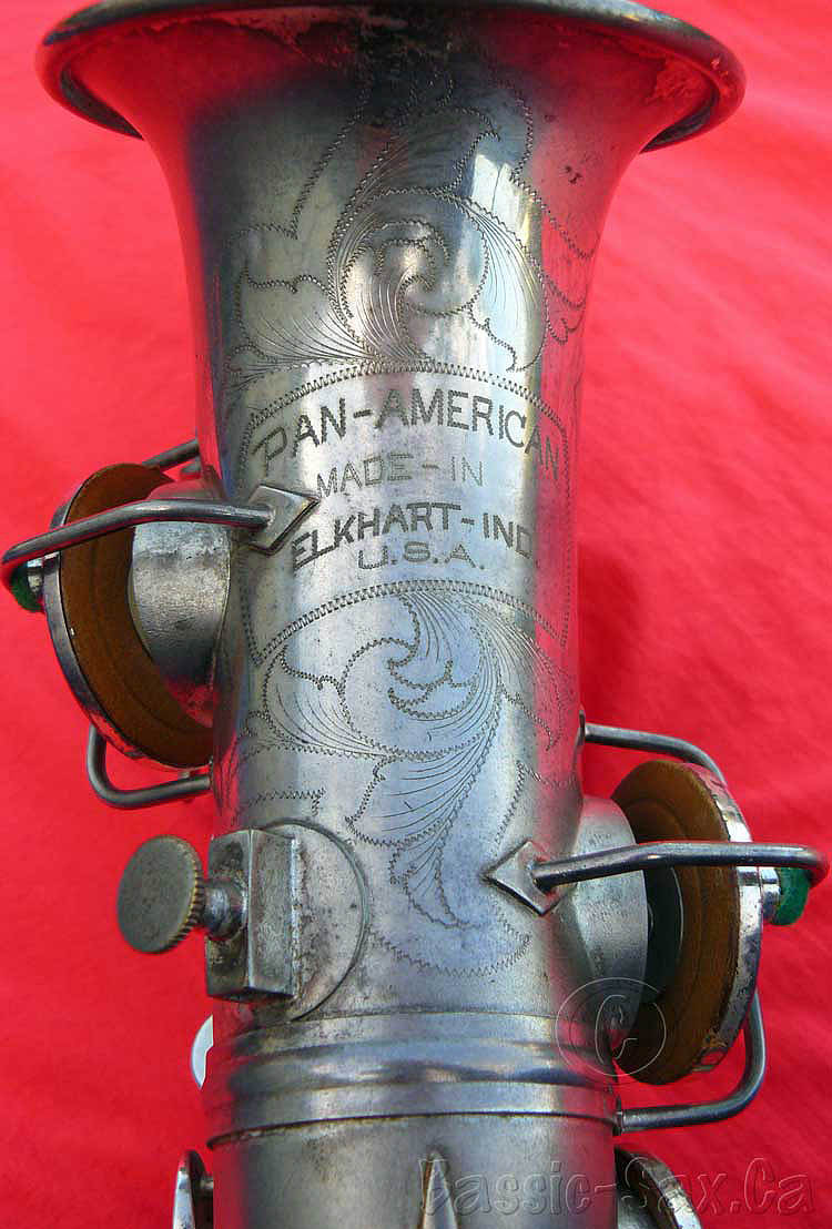 saxophone bell, Pan American saxophone, curved soprano, vintage sax, silver sax, red background